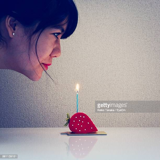 Woman Blowing Birthday Candle