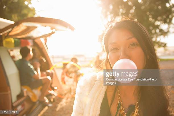 """woman blowing bubble gum bubble outdoors - """"compassionate eye"""" stock pictures, royalty-free photos & images"""