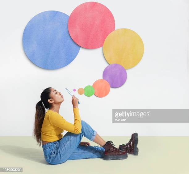 woman blowing bubbles - inspiration stock pictures, royalty-free photos & images