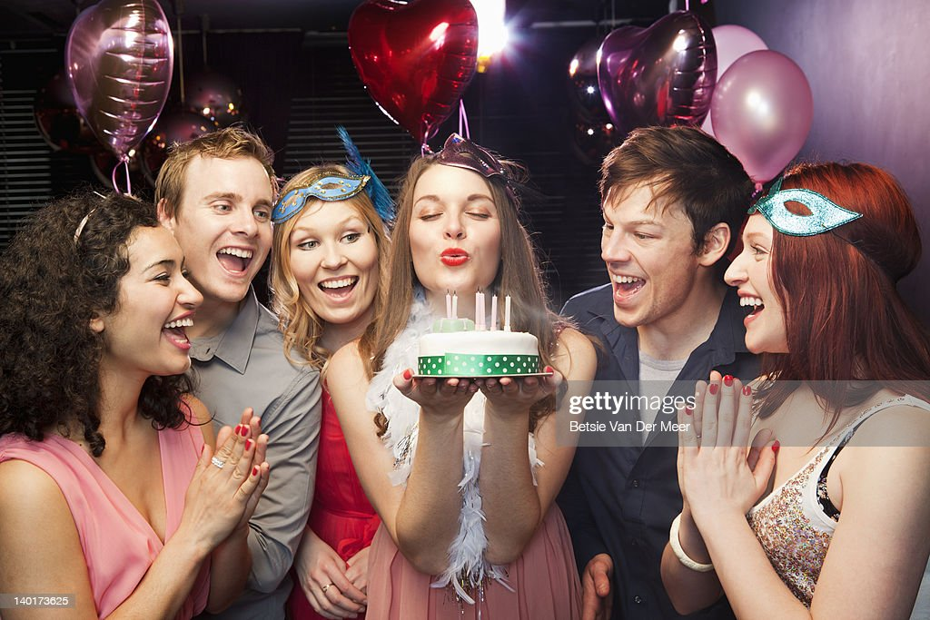 Woman blowing candles of birthday cake. : Stock Photo