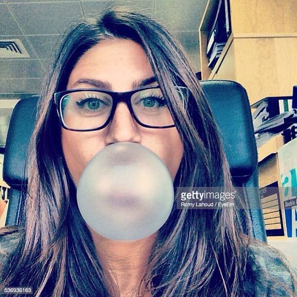 Woman Blowing Chewing Gum Bubble