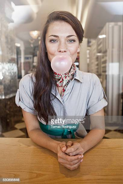 Woman blowing gum bubble