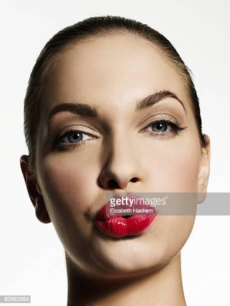 Woman blowing kiss towards camera