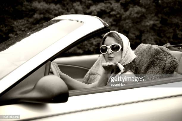 woman blowing kisses from a convertible - headscarf stock pictures, royalty-free photos & images