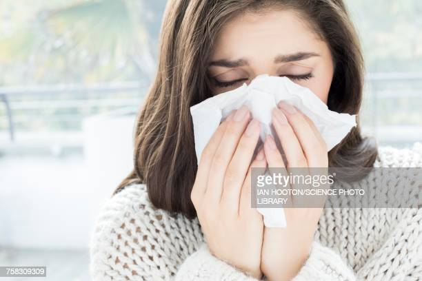 woman blowing nose on tissue - handkerchief - fotografias e filmes do acervo