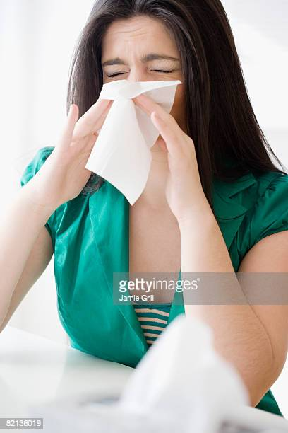 woman blowing nose - long nose stock photos and pictures