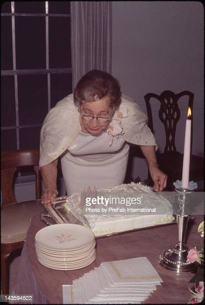 Woman blowing out her birthday candles