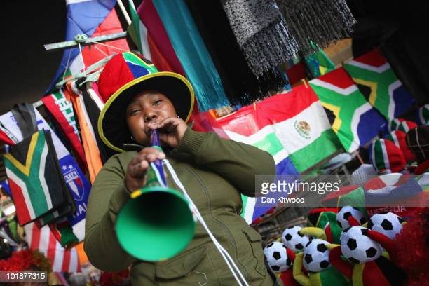 A woman blows a Vuvuzela in central Cape Town on June 8 2010 in Cape Town South Africa The first World Cup ever held in Africa is due to begin in...