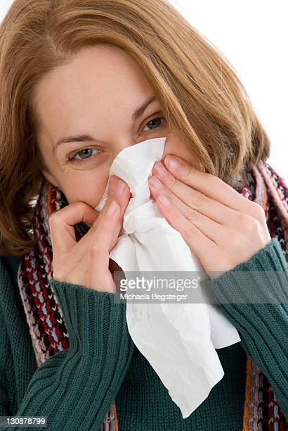 Woman blows her nose
