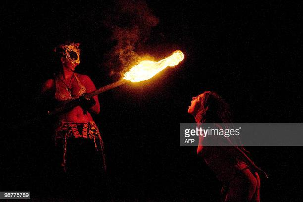 A woman blows on a torch during the Beltane Fire Festival in Edinburgh on April 30 2010 The event which celebrates an ancient Celtic festival is a...