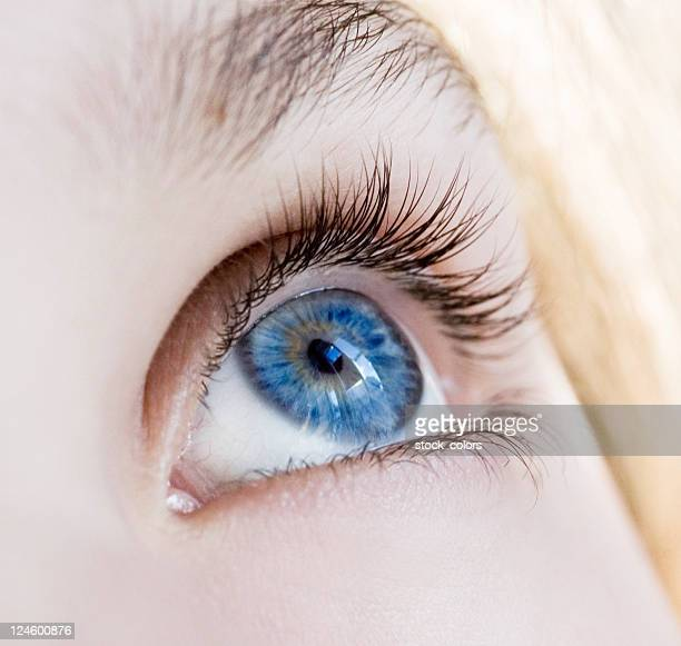woman blue eyes - lens eye stock photos and pictures