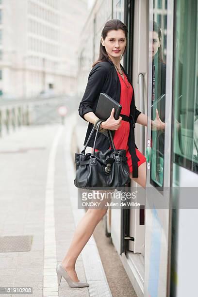Woman boarding a bus