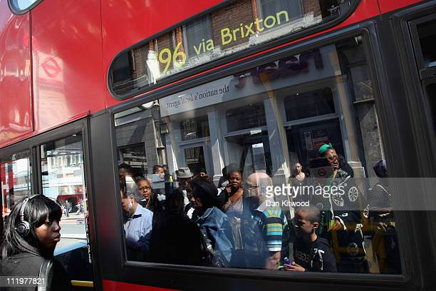 A woman boards a bus in Brixton on April 11 2011 in London England Today marks the 30th anniversary of the Brixton riots The 1981 Brixton riots took...