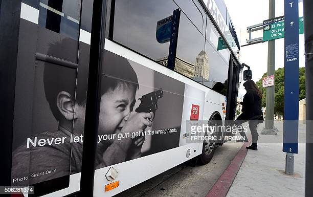 A woman boards a bus in Los Angeles on January 22 2016 A public awareness campaign which debuted this week on some city buses shows a young boy...