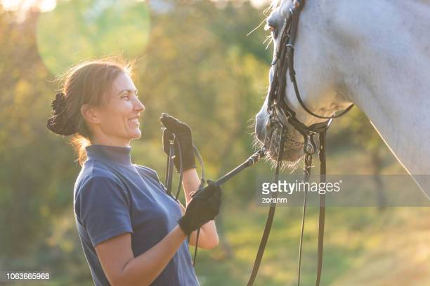 woman bonding for horse - racehorse stock pictures, royalty-free photos & images