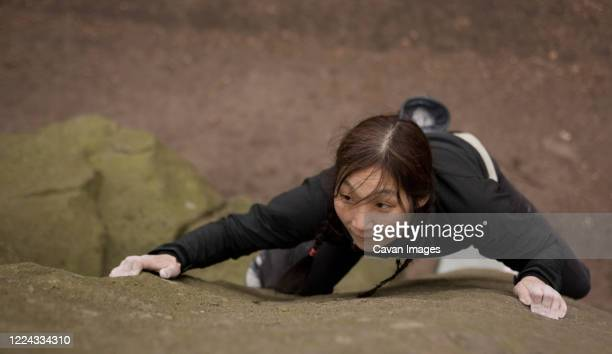 woman bouldering on grid stone in the peak district / uk - extra long stock pictures, royalty-free photos & images