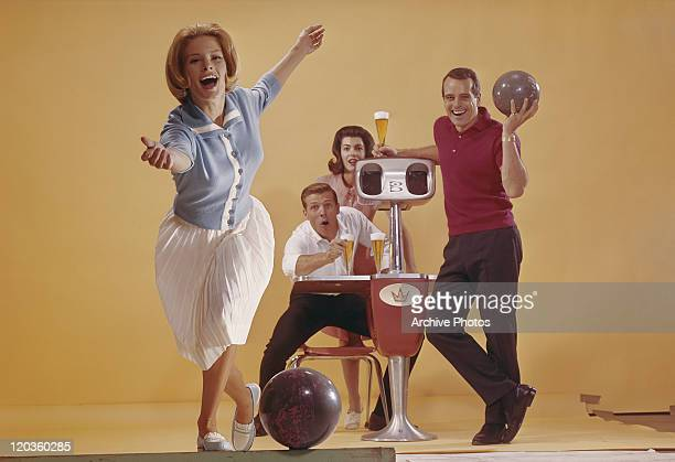 Woman bowling, friends in background with beer glass