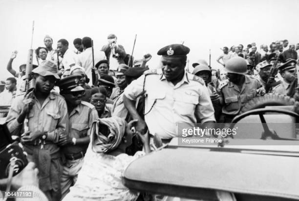 A woman bows down before the President and dictator of Uganda Idi AMIN DADA in the 1970's