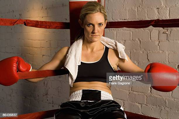 Woman Boxer Sitting in Ring.