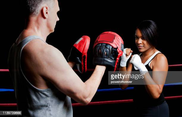 Woman Boxer Training with Coach
