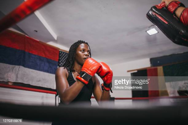 woman boxer training with coach - women's boxing stock pictures, royalty-free photos & images