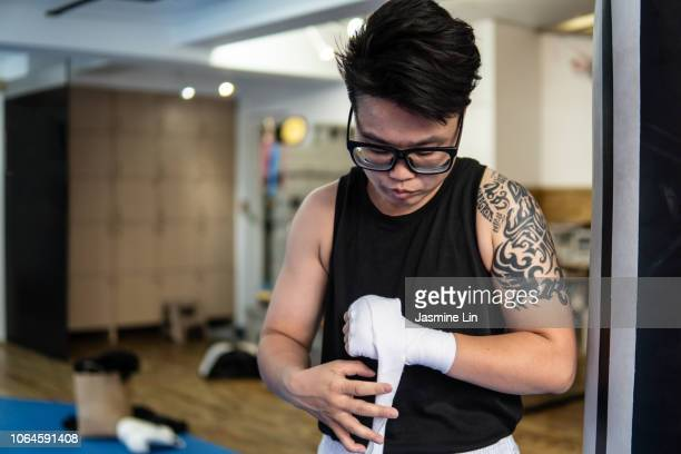 Woman boxer wrapping hands