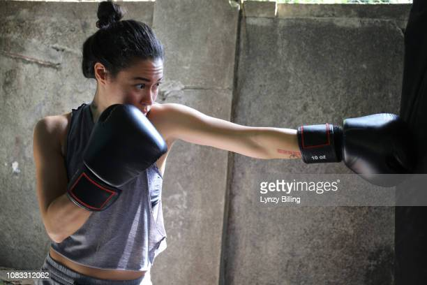 woman boxing in her garage