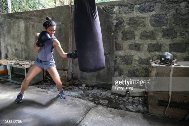 woman boxing in her garage - filipino ethnicity and female not male stock pictures, royalty-free photos & images