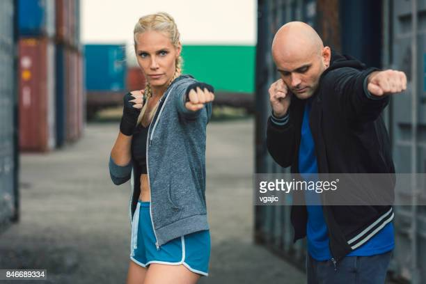 Woman boxing with her personal trainer