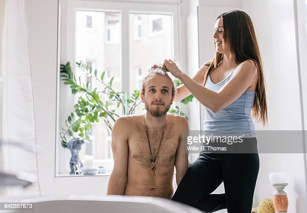 Woman braiding Boyfriend's hair