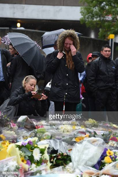 A woman breaks down in tears after a minutes silence near the scene of Saturday's terrorist attack on June 6 2017 in London England The third...