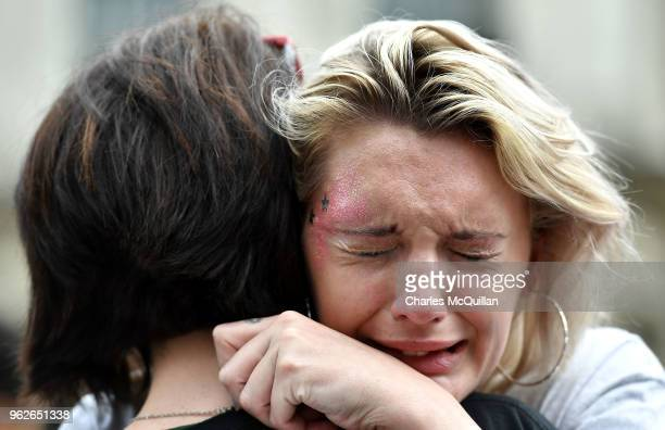 A woman breaks down in tears as the results in the Irish referendum on the 8th amendment concerning the country's abortion laws takes place at Dublin...