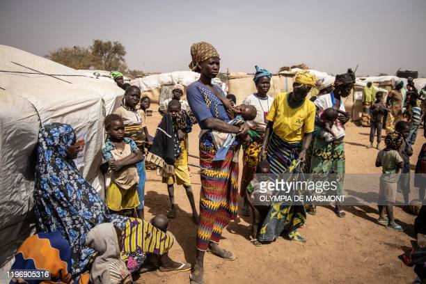 A woman breastfeeds her child in a camp for internally displaced people in Barsalogho on January 27 2020 Barsalogho is a small town in northern...