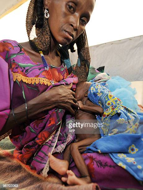 A woman breastfeeds her malnourished baby at an intensive nutritional rehabilitation center in Tanout southern Niger on April 27 2010 The UN's food...