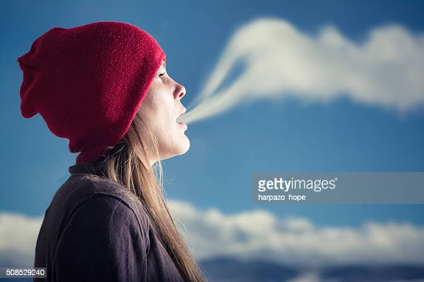 Woman breathing a cloud.