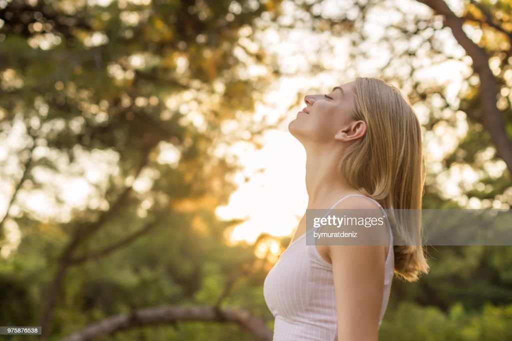 Woman breathing fresh in forest : Stock Photo
