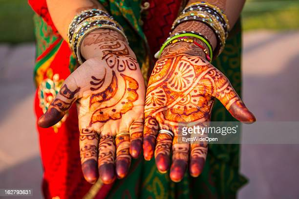 Woman bride with henna tattoo near the famous indian sightseeing point Taj Mahal on December 01 2012 in Agra Uttar Pradesh India The UNESCO World...