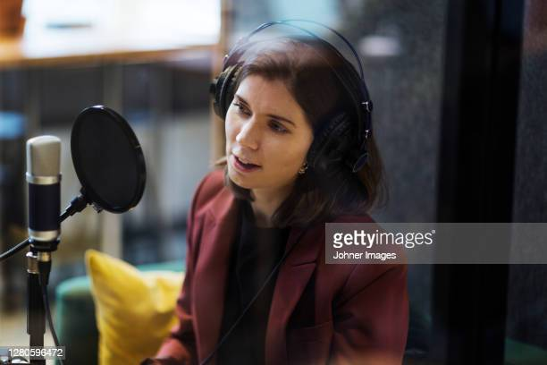 woman broadcasting from radio station - journalist stock pictures, royalty-free photos & images