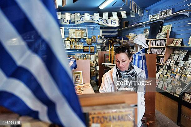 A woman browses Greek merchandise in Oakleigh a suburb of Melbourne Australia on Tuesday June 12 2012 Armed with patriotism and the bestperforming...