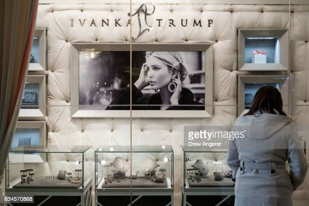 A woman browses jewelry for sale at the 'Ivanka Trump Collection' shop in the lobby at Trump Tower February 10 2017 in New York City According to a...