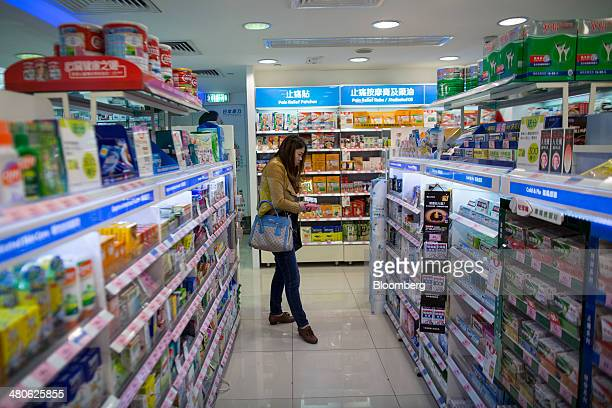 A woman browses medicine in a Watsons store operated by AS Watson Co in the Tsim Sha Tsui district of Hong Kong China on Tuesday March 25 2014...
