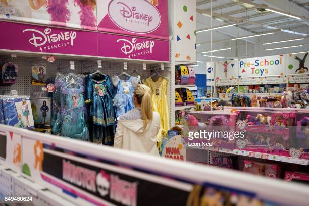A woman browses the toy selection in a branch of the toy store Toys R Us on September 19 2017 in Luton England The company has struggled to compete...