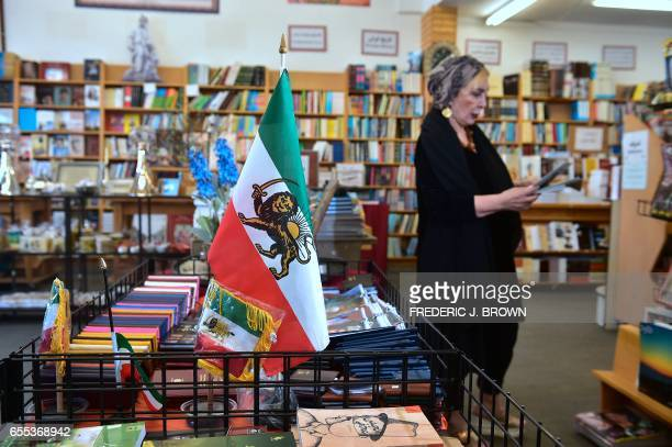 A woman browses through a selection of periodicals at a bookstore along Westwood Boulevard on March 15 in a neighborhood known unofficially as...