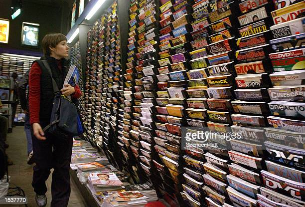 Woman browses through a variety of publications at a magazine store April 30, 2002 in New York City. Revenue from magazine sales at newsstands has...