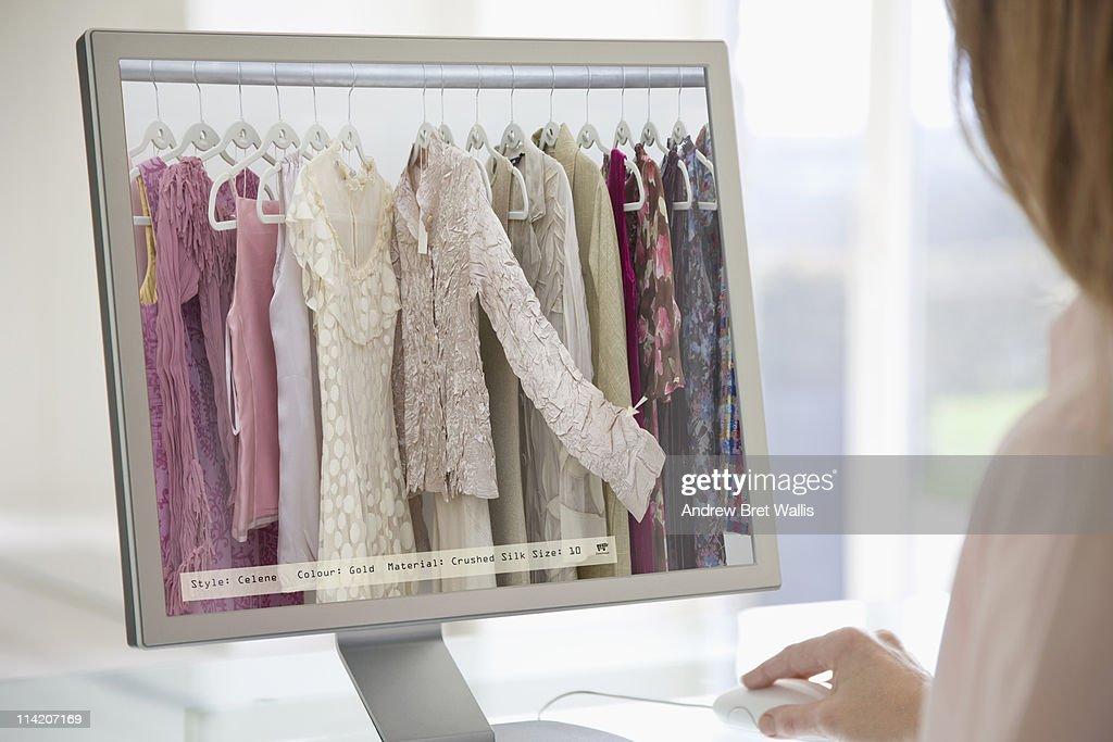 Woman browsing a digital clothes rail on-line : Foto de stock