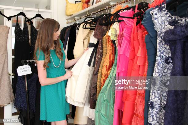 woman browsing boutique - palm beach county stock photos and pictures