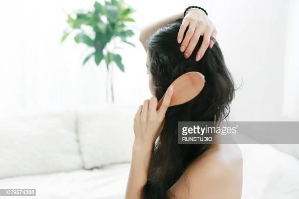 woman brushing hair - body massage japan stock pictures, royalty-free photos & images