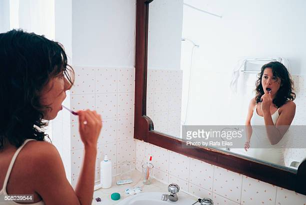 woman brushing her teeth - brushing teeth stock pictures, royalty-free photos & images