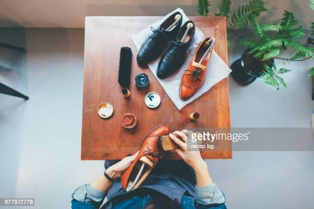 Woman brushing shoe