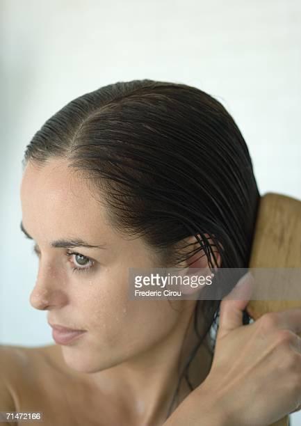 Woman brushing wet hair